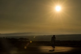 Limited edition fine art cycling print of a silhouetted cyclist riding into the sunrise on the Big Island in Hawaii. Shot for Cyclist Magazine by Patrik Lundin - cycling prints, fine art cycling print, limited edition prints, limited edition cycling prints, cycling photos, cycling images, cyclist, hairpin, hairpin road, cycling, cyclist magazine, gift, gift for cyclists