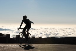 Limited edition fine art cycling print of a silhouetted cyclist above the clouds on Mauna Kea Vulcano on the Big Island in Hawaii. Shot for Cyclist Magazine by Patrik Lundin - cycling prints, fine art cycling print, limited edition prints, limited edition cycling prints, cycling photos, cycling images, cyclist, hairpin, hairpin road, cycling, cyclist magazine, gift, gift for cyclists