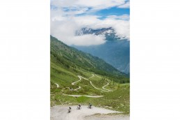 Limited edition fine art cycling print of 3 cyclists riding the gravel hairpins of Colle delle Finestre. The cl famous climb often feature in the Giro d'italia Shot for Cyclist Magazine by Patrik Lundin - cycling prints, fine art cycling print, limited edition prints, limited edition cycling prints, cycling photos, cycling images, cyclist, hairpin, hairpin road, cycling, cyclist magazine, gift, gift for cyclists